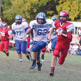 Keegan Collins takes a carry for a nice gain during the Southern Buckeye Warriors' Sept. 9 battle against Middletown Christian.