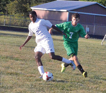 Ripley's Nigel Royal is on the attack while Fayetteville's Christian Hansel moves in to defend during the Sept. 20 game at Ripley.