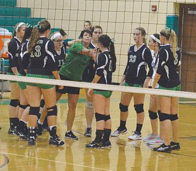 Fayetteville-Perry volleyball coach Sharon Sheets instructs her Lady Rockets during a match this season.