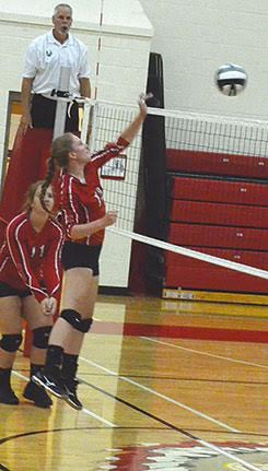 Eastern's Haley Fannin comes through with a kill.