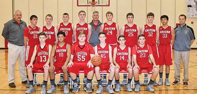 The Eastern Warriors take the court for their 2016-17 basketball campaign. Front row, from the left, are Titus Burns, Marcus Hamilton, Kaleb Martin, Ethan Battson, Gage Boone, and Jordan Johnson; back row, assistant coach Tim Boone, Logan Lainhart, Dakota Hiser, Josh Tolle, Dare Minton, head coach Rob Beucler, Garyn Purdy, Jacob Diener, Blake Rigdon, TJ Stivers, and assistant coach Rich Kelch.