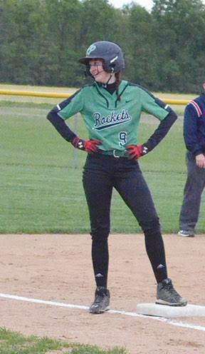 Fayetteville's Gabby Jones stands at third base after smacking a triple during a Lady Rocket win.