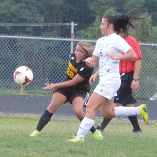 Georgetown's Amaya Lovell fires off a shot through Ripley defenders during the Lady G-Men's Sept. 10 win.