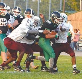 Chase Jester carries for his first of seven touchdowns in the Rockets' week five win over Hillcrest, Sept. 23. Jester rushed for a total of 383 yards, setting a new single-game rushing record at Fayetteville-Perry.