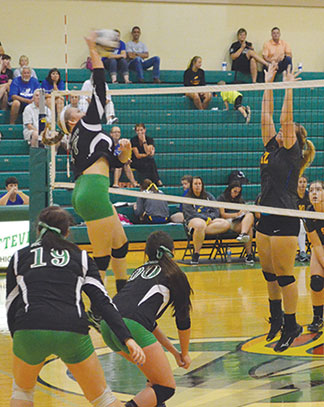 Fayetteville's Lexi Estes hammers down a spike in the Sept. 19 match against Clermont Northeastern.