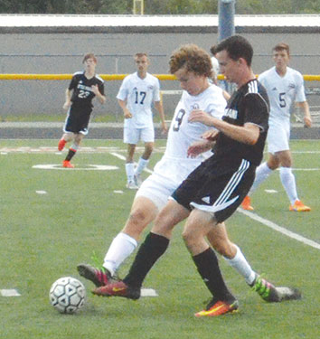 Western Brown's Wesley O'Hara defends against a Little Miami attacker during a non-league contest at Kibler Stadium/LaRosa's Field.