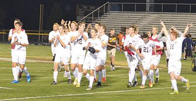The Western Brown Broncos celebrate their sectional tournament win over Monroe during their last home game of the season at Kibler Stadium/LaRosa's Field on Oct. 20.