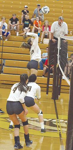 Western Brown's Rylie Young goes up for a spike in a Lady Broncos' league win this season.