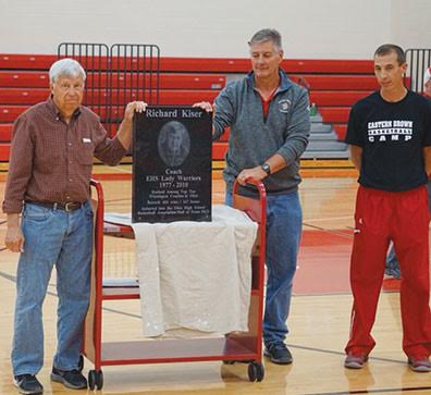 Eastern High School's retired varsity girls basketball coach, Richard Kiser, receives a special award during the Nov. 5 Joe Myers Sports Festival for his many years of success as a coach. Presenting Kiser with his award were Eastern High School varsity boys basketball coach Rob Beucler and the current Eastern High School varsity girls basketball coach Kevin Pickerill.